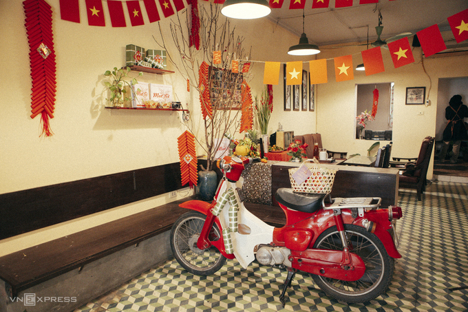 four coffee shops with tet holiday themed decorations in hanoi