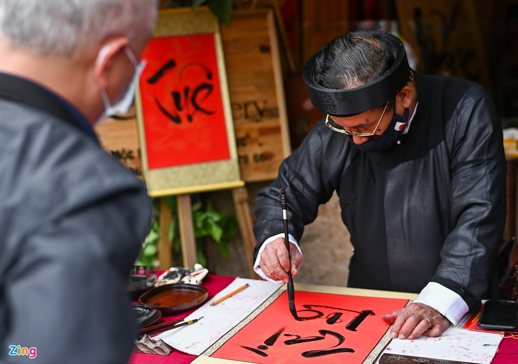 calligraphers wear face masks give words in temple of literature