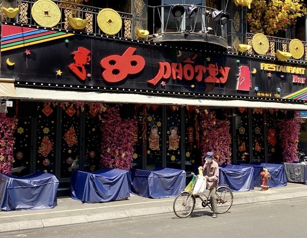 Ho Chi Minh city reopens gyms, pubs, beer clubs; bars remain shut down