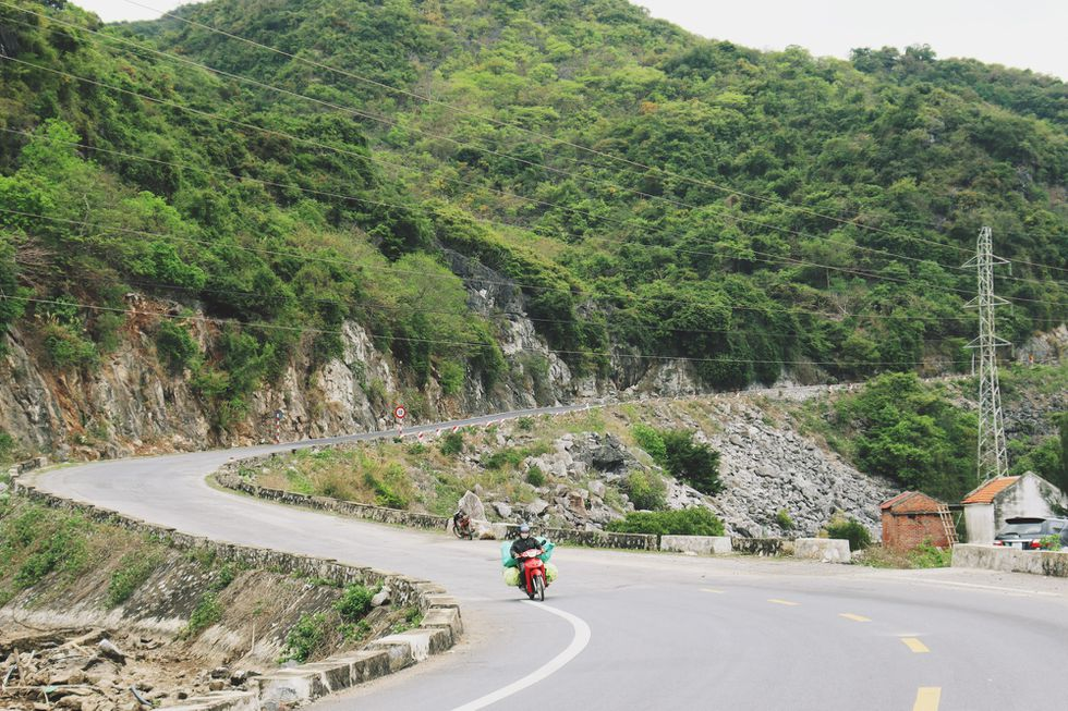 Coastal road in Cat Ba Island, a 'not-to-be-missed' destination for backpackers