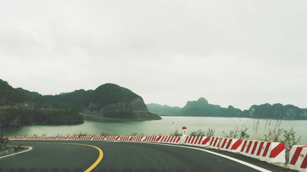 coastal road in cat ba island a not to be missed destination for backpackers