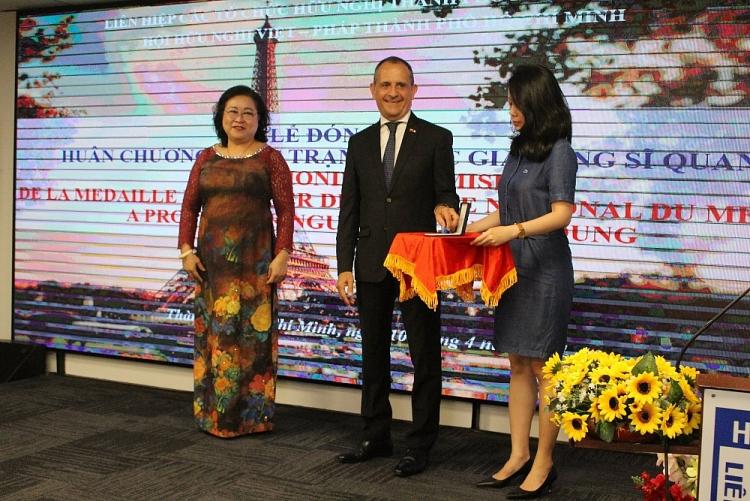 HCMC Vietnam - France Friendship Association's President awarded France's National Order of Merit