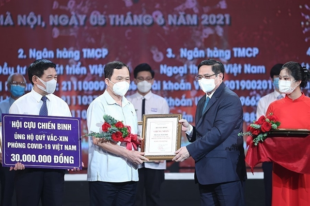 Overseas Vietnamese supports homeland's Covid-19 vaccine fund
