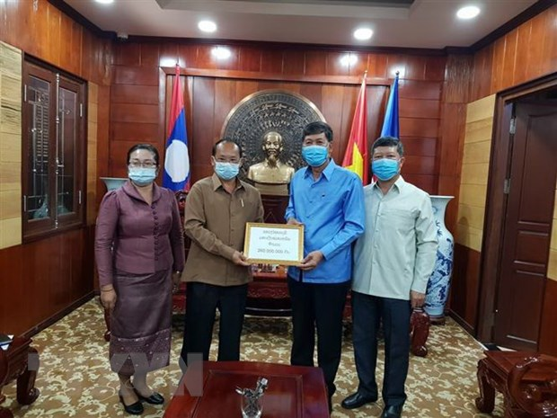 Lao provides financial support for Vietnam northern provinces