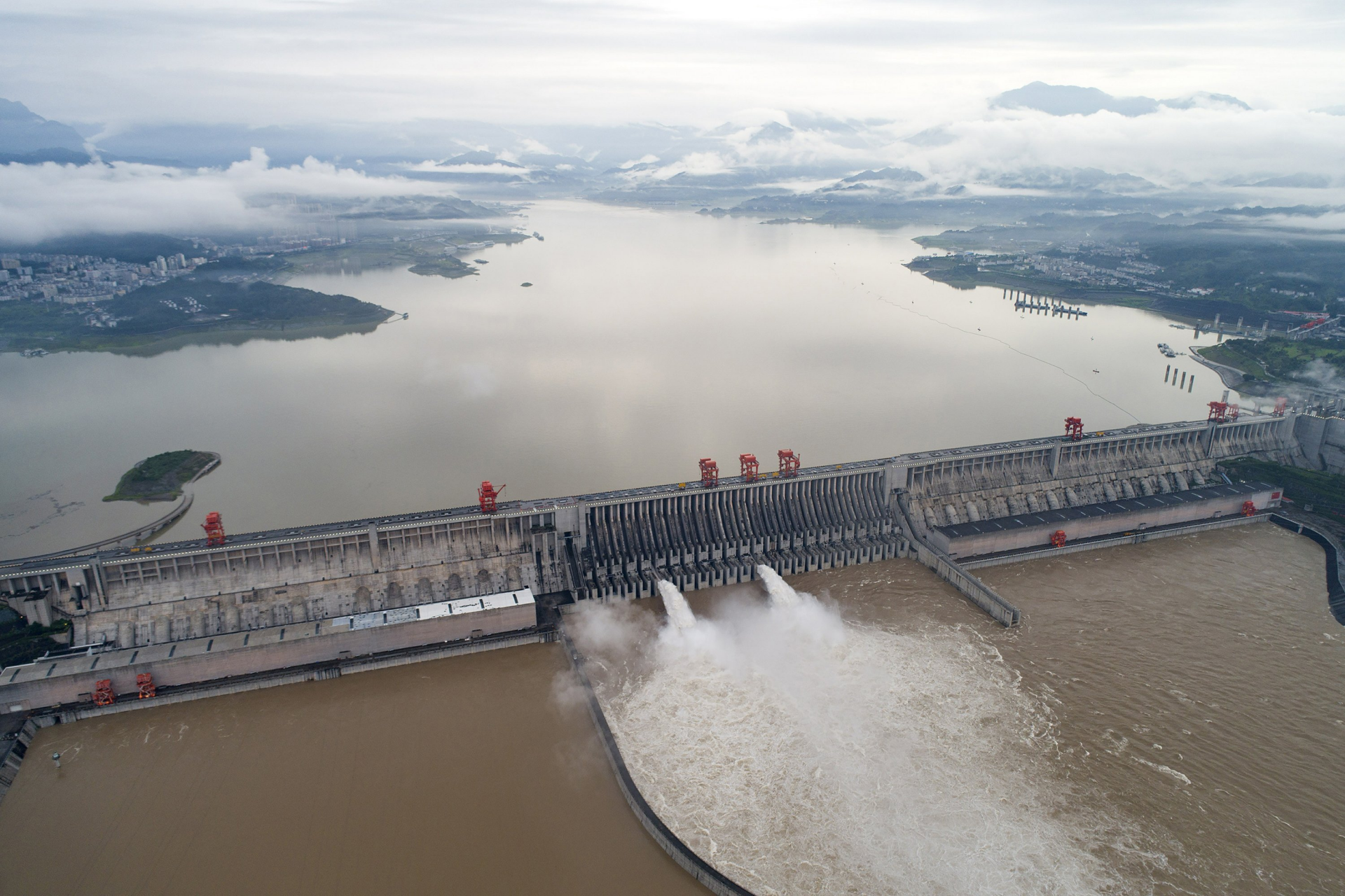 china massive flood updates china blows up dam to discharge floodwaters as death toll increases