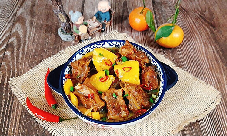 traditional recipe of young ribs braised with pineapple for tet holiday