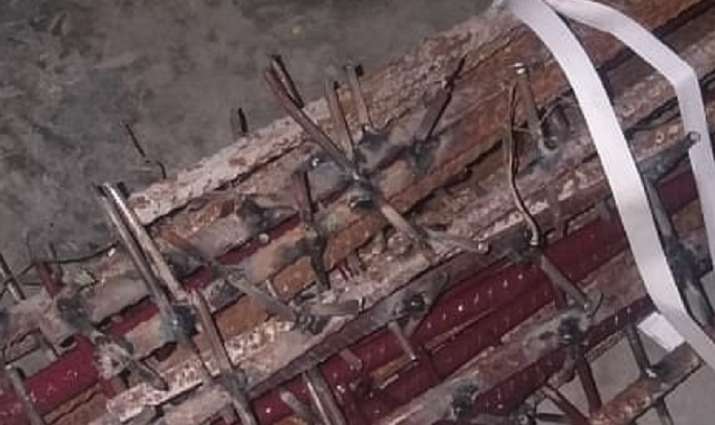 picture of nail studded iron rod in china inda clash is fake