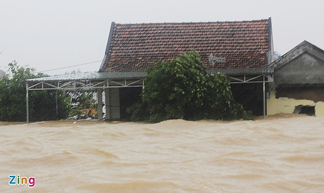 In Photos: Record flooding in central Vietnam, thousands of houses deluged in water