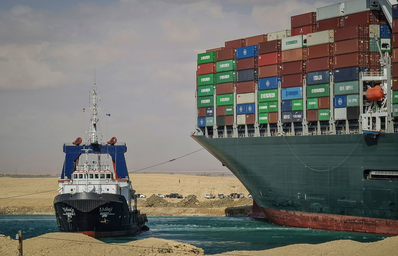 giant container ship stuck is causing traffic jam on suez canal