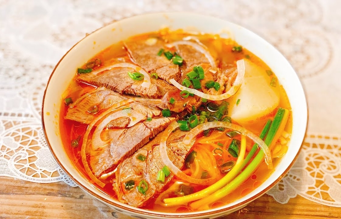 Homemade recipe for 'Bun Bo Hue' (Hue style beef noodle soup) with popular ingredients