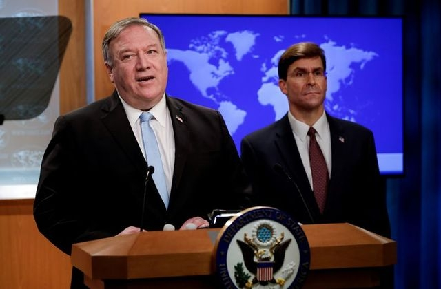 U.S. Secretary of State Mike Pompeo speaks about a Trump administration executive order on the International Criminal Court as Defense Secretary Mark Esper listens during a joint news conference at the State Department in Washington, U.S., June 11, 2020