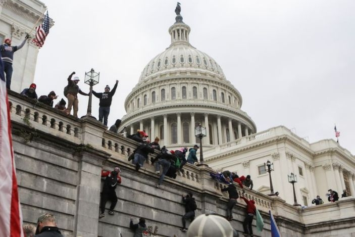 Supporters of U.S. President Donald Trump climb on walls at the U.S. Capitol during a protest against the certification of the 2020 U.S. presidential election results by the U.S. Congress, in Washington, U.S., January 6, 2021 (Photo: Reuters)