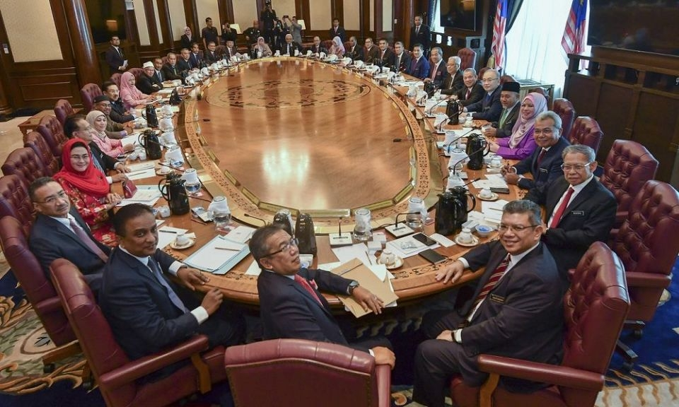 Prime Minister Tan Sri Muhyiddin Yassin poses with Cabinet ministers before its first meeting at Perdana Putra in Putrajaya March 11, 2020 (Photo: Bernama pic)