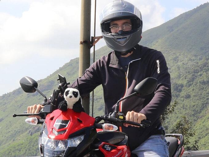 Tobias Bremner and Hunter - the stuffed panda on his motorbike (Photo courtesy of Tobias Bremner/ via VNE)