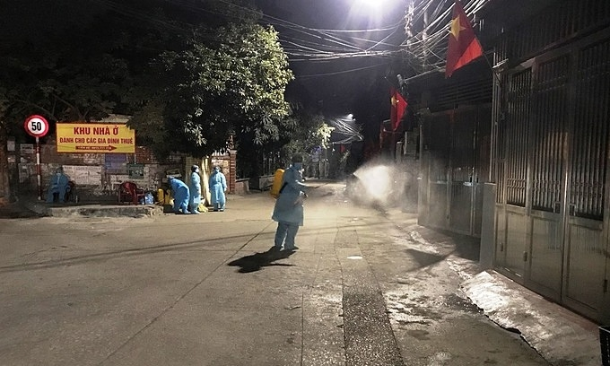 Medical workers disinfect a neighborhood in the northern quang ninh province after person was confirmed infected with covid-19, january 27, 2021.