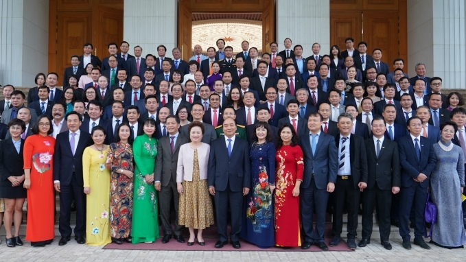 Prime Minister Nguyen Xuan Phuc and outstanding entrepreneurs at a meeting in 2020 (Photo: VGP)