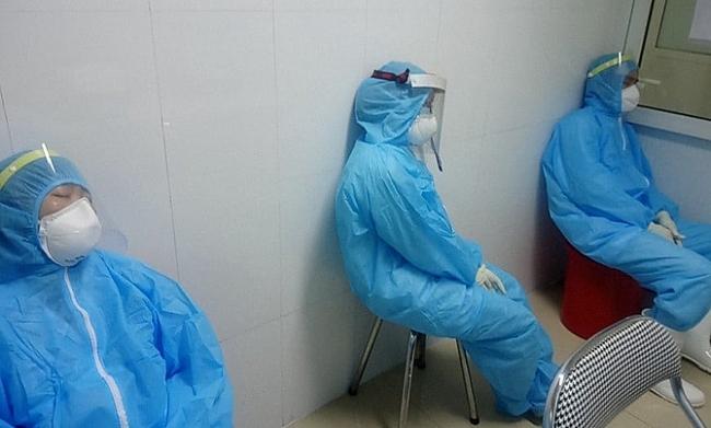 Medics brave pouring rain to track coronavirus amist rising cases