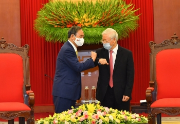 vietnam news today march 23 top leader holds phone talks with japanese pm suga