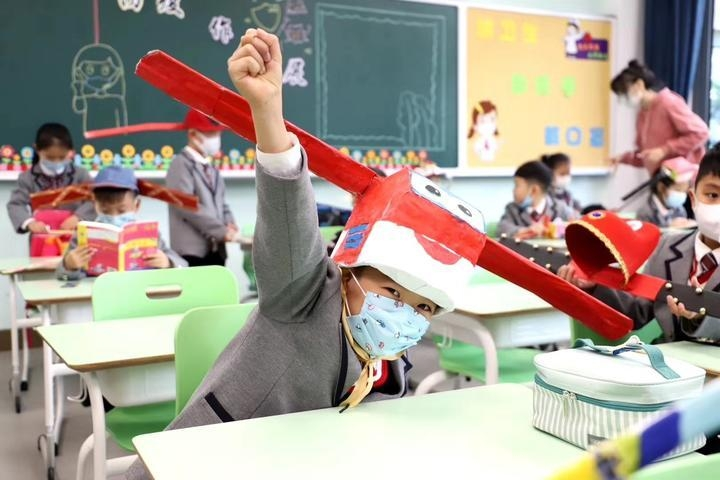 chinese primary students return schools with self made distancing hats