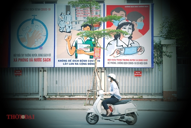 posters raise public awareness of covid 19 prevention in vietnam photos