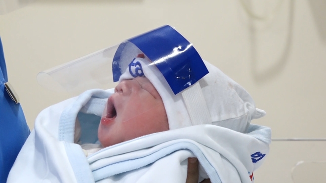 hanoi newborns get face shields for covid 19 protection