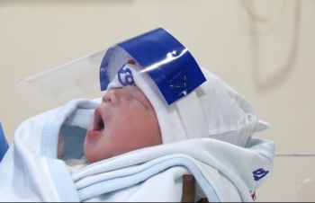 vietnam newborns get face shields for covid 19 protection