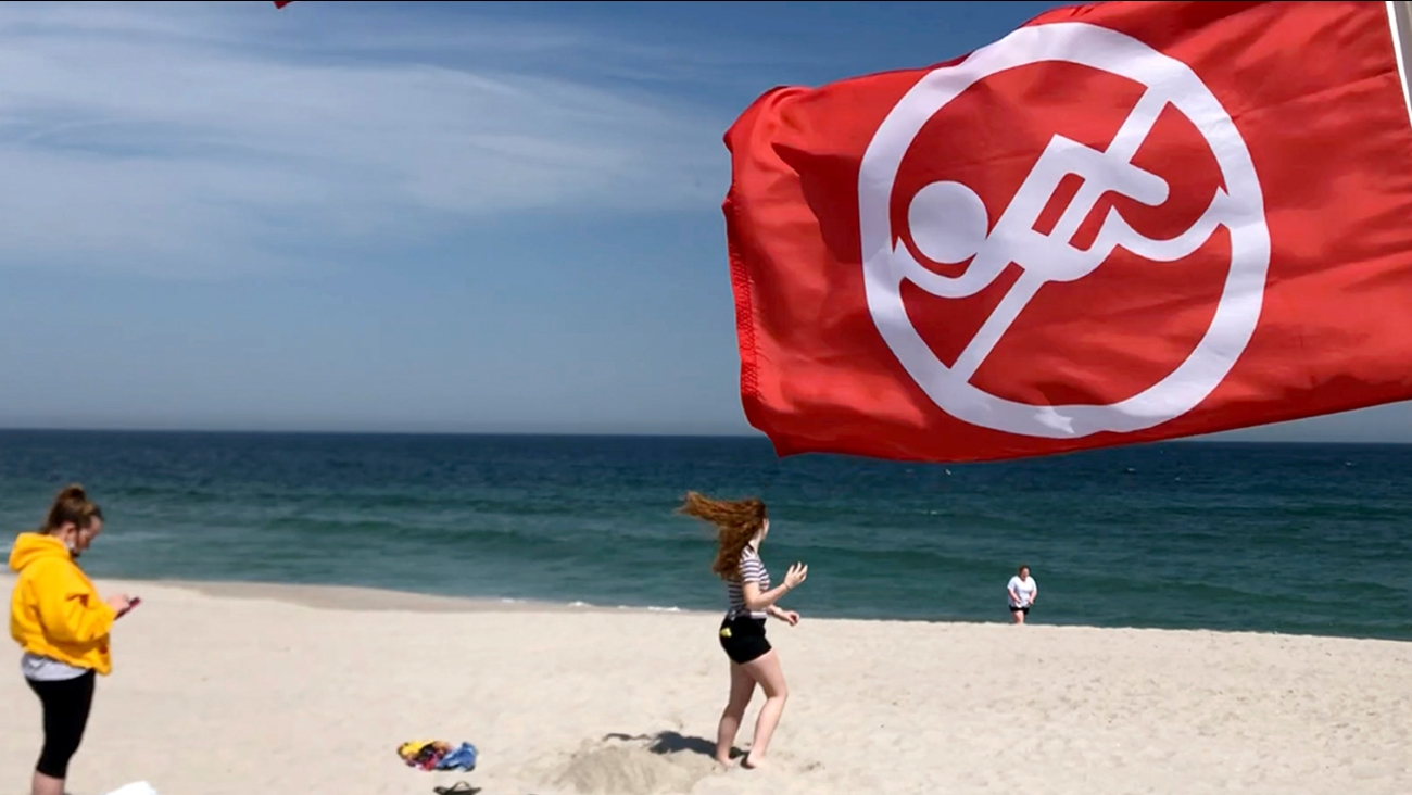 restrictive measures in place as us beaches reopen for memorial day amid covid 19 pandemic