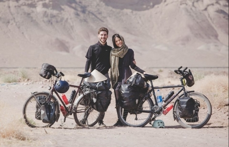 honey moon cycling tour to 18 countries for fundraising spreads love message