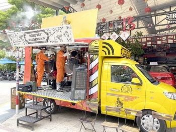 hcmc classy looked barbershop in caravan truck offers free haircut for the poor