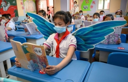 Chinese students wear adorable 'social distancing wings' at school