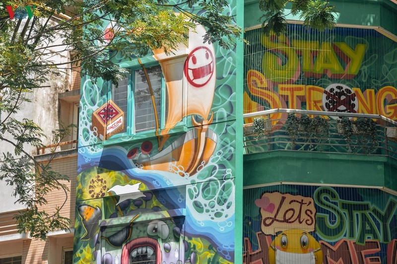 artful masion in hanoi with covid 19 themed communication graffiti catches attention