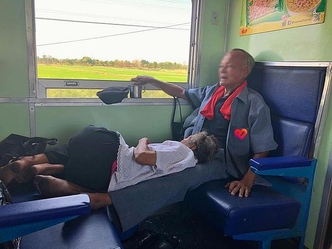 Melting heart photo of old woman slumbering on husband's legs on Vietnam
