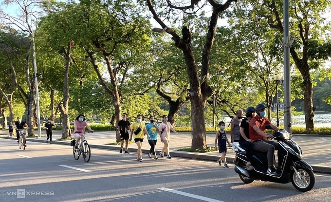 Ho Chi Minh City reports record 1 day increase in Covid cases, Hanoi eases preventive measures