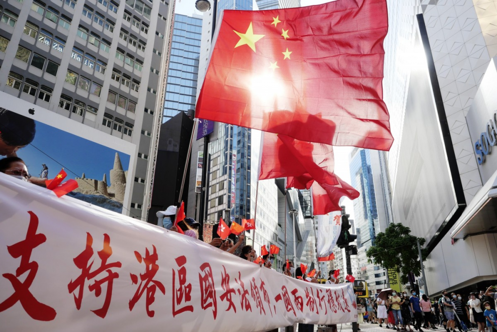 world news today july 1 chinese president xi signs hong kong national security law into effect