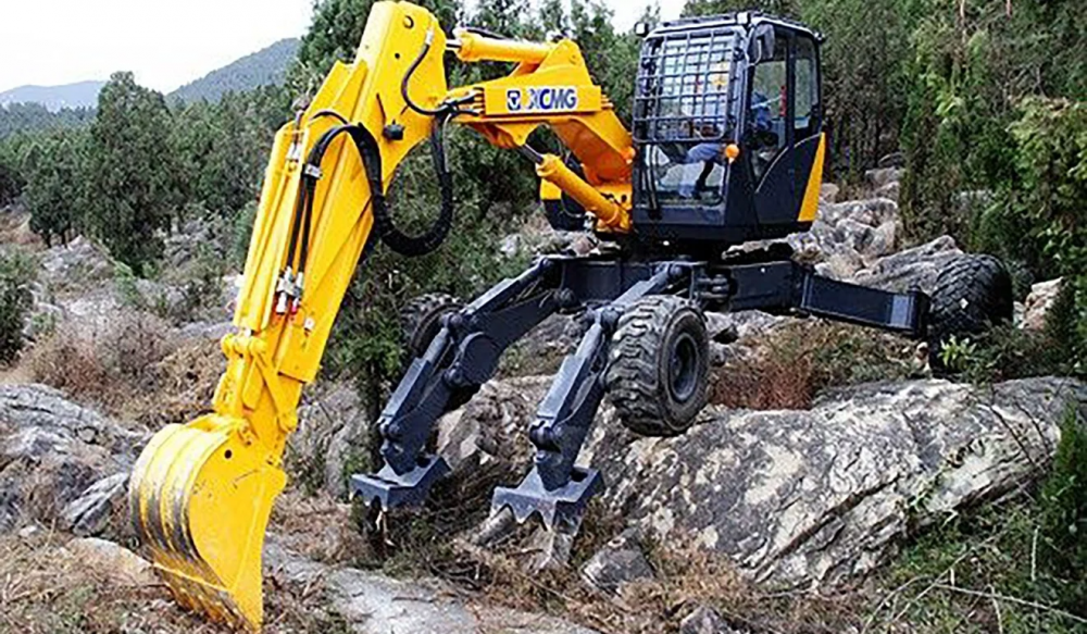 Chinese troops are using all-terrain walking excavators to speed up road-building and other construction work in the rugged Himalayas near the country's disputed border with India