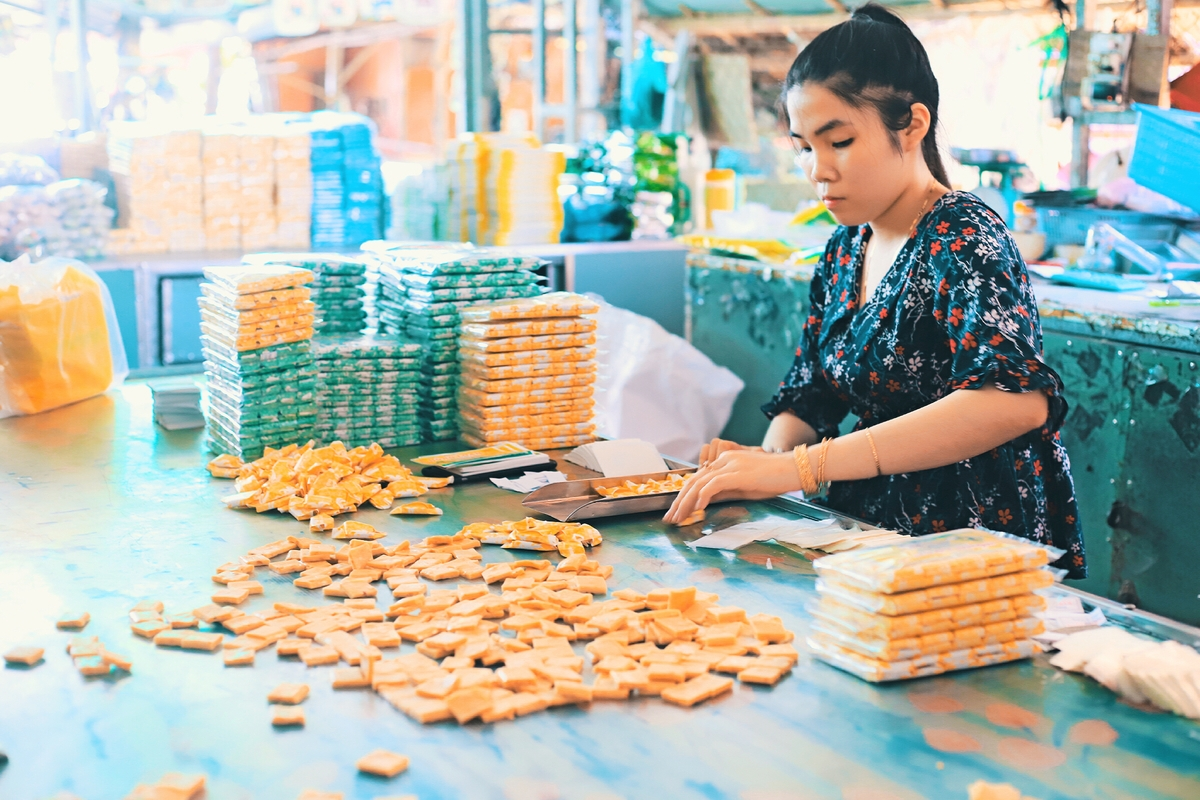 A local making coconut candies