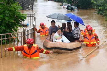 china flood latest news four cities declare top level warnings millions people affected