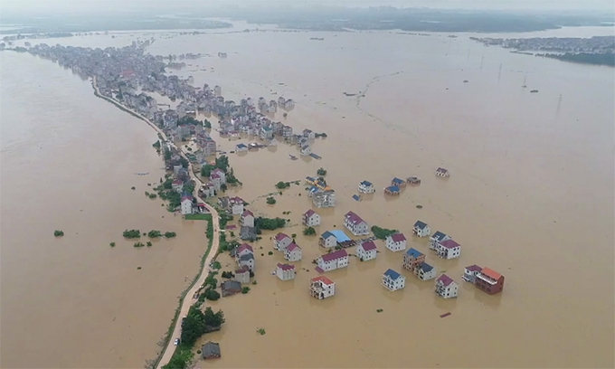 Inundated buildings and vehicles in Shexian County, Huangshan City, Anhui Province, China