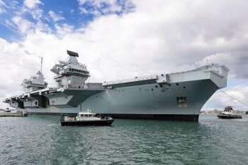 world news today july 19 china warns uk over basing aircraft carrier in the pacific