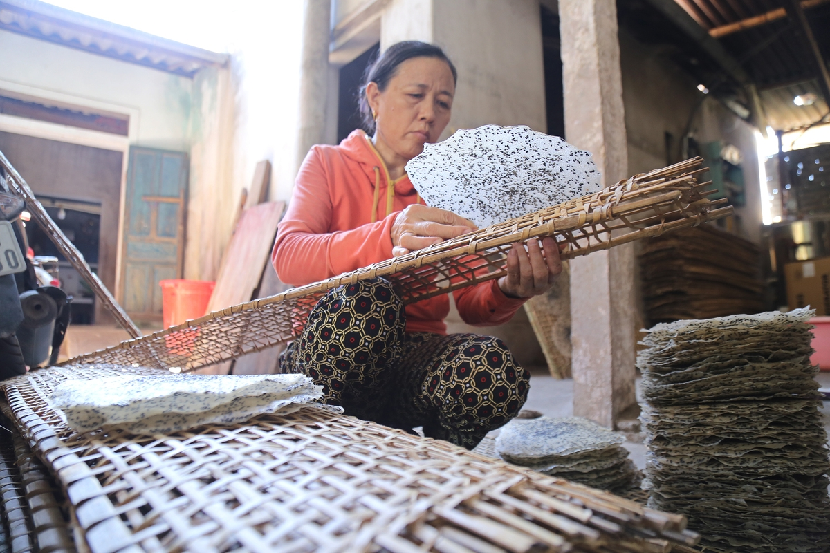 rice paper making under burning sun in central vietnam