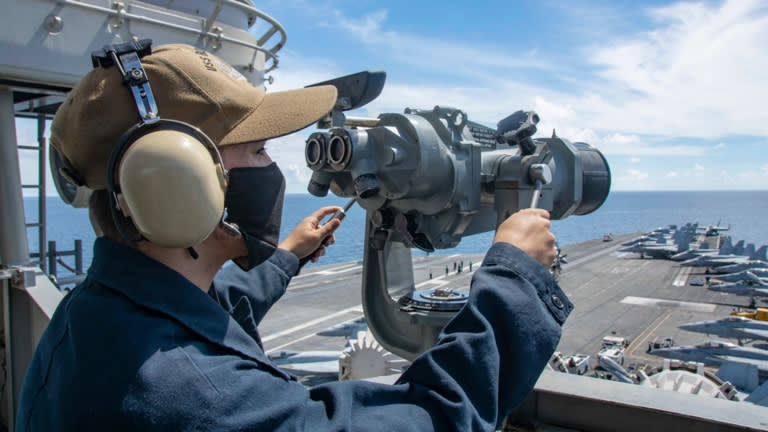 Seaman alexander chitty stands forward lookout watch on the signal bridge of navy's only forward-deployed aircraft carrier uss ronald reagan in bien dong sea