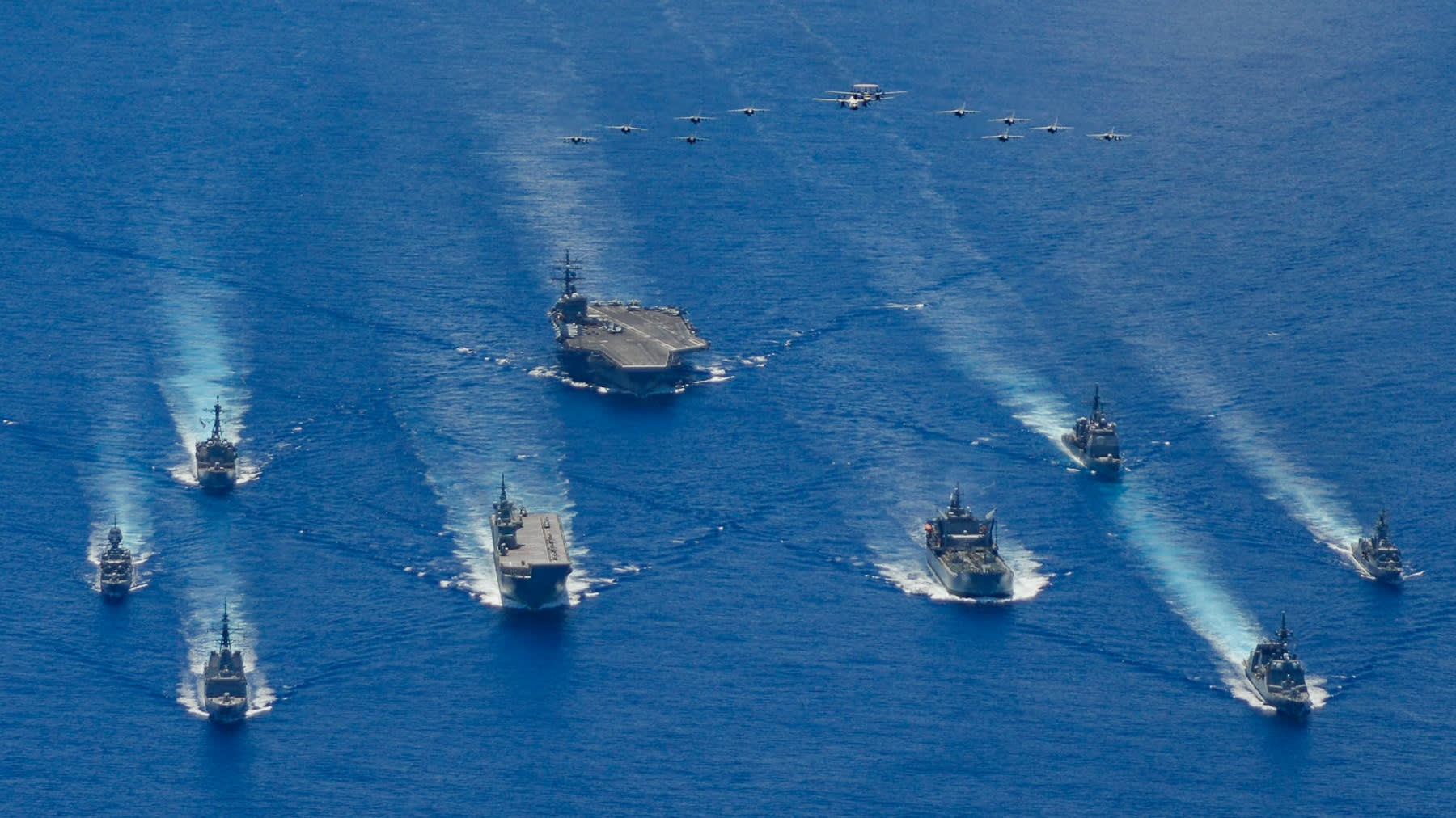 The ronald reagan carrier strike group and units from the japan maritime self-defense force and australian defense participate in trilateral exercises the philippine sea on july 21