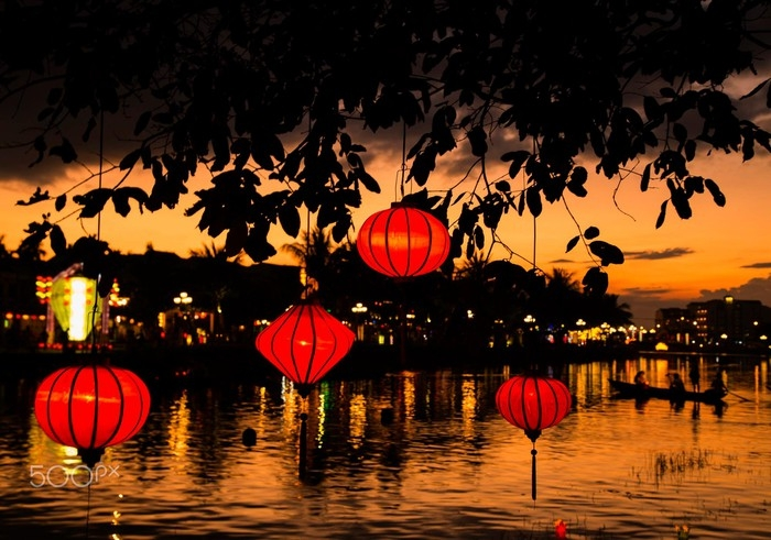 Sunset on Thu Bon River. Once again, the lanterns add color and charm to the already graceful town.