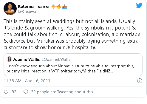 photo of chinese ambassador to kiribati walking across locals backs ignites debates