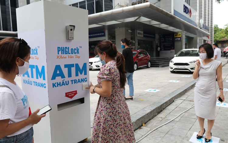 Free face mask atm with automatic facial recognition utility appears in hanoi