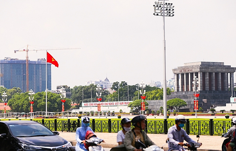 The streets in Hanoi is filled with flags and banners