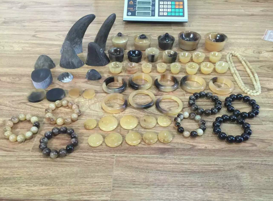 An undercover photograph of raw and carved rhino horn for sale in vietnam.