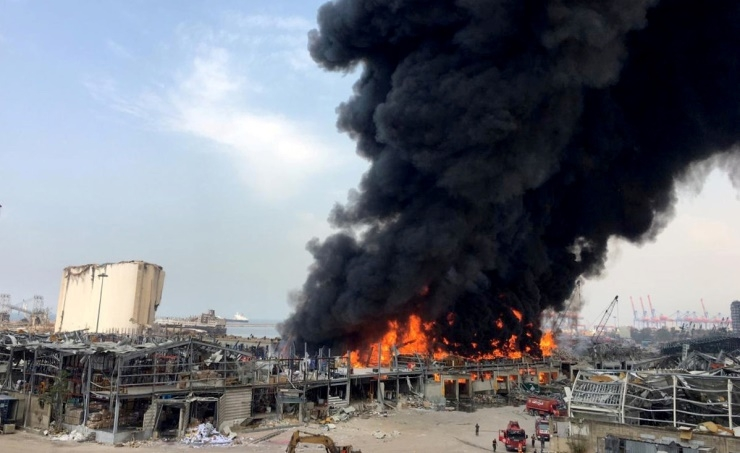 A large fire erupted at Beirut port on Thursday, engulfing parts of the Lebanese capital in a pall of smoke