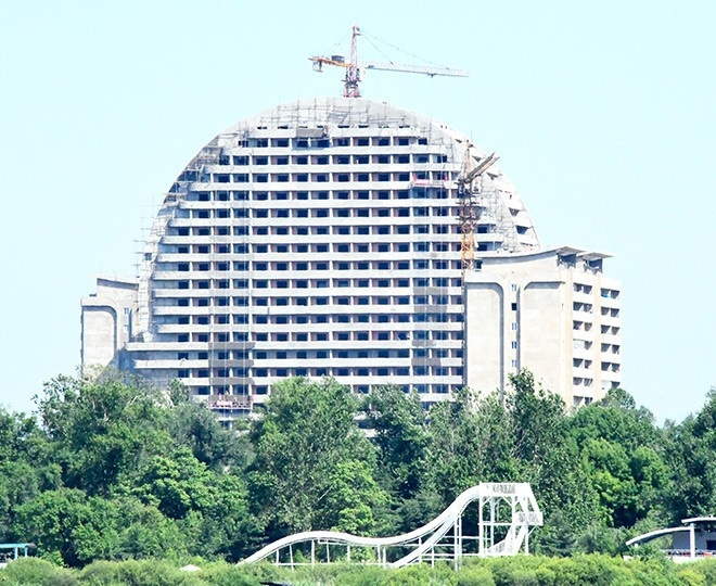 A high-rise building is seen under construction in North Korea on the opposite side of the Amnok river in this photo taken from Dandong, China, in June 2019. (Yoshikazu Hirai)