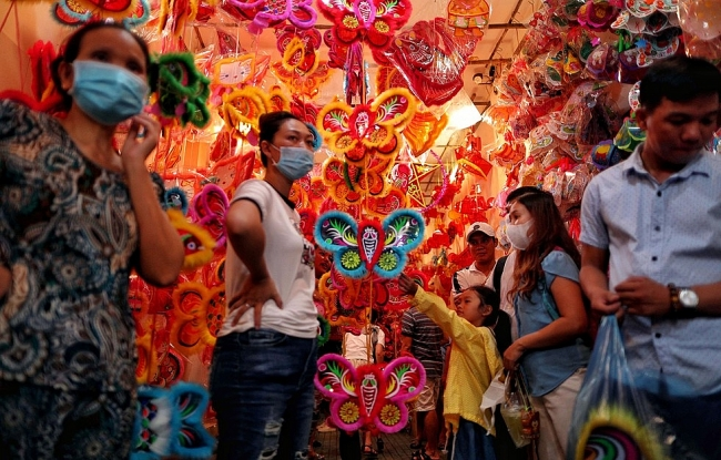 Lantern street in Saigon jam-packed with holiday goers